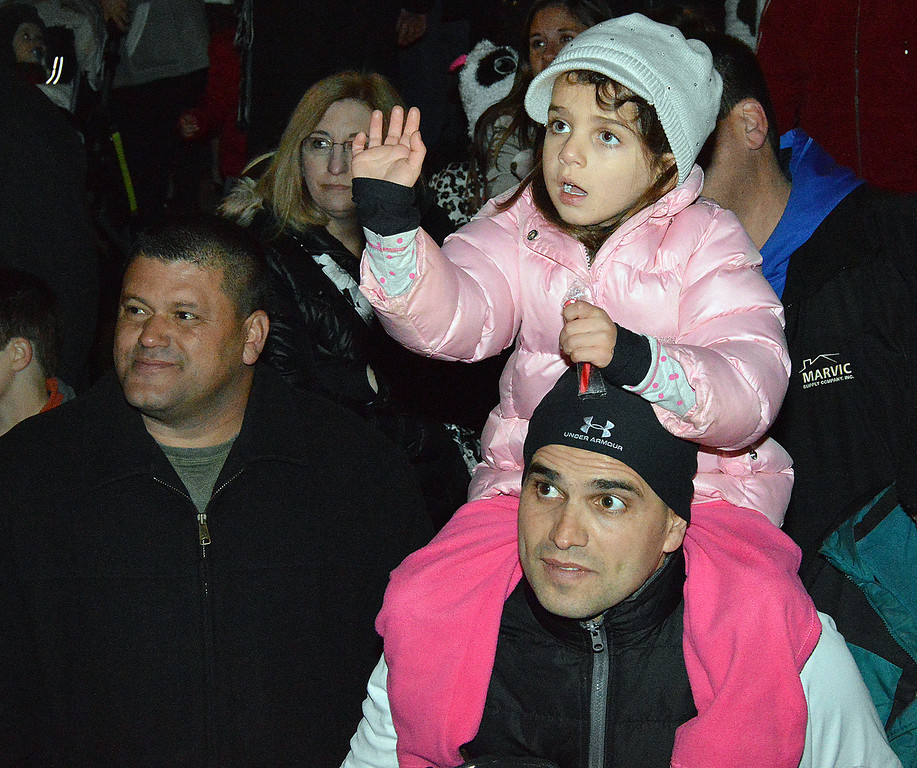 Description of . News-Herald photo — DEBBY HIGH The crowd watches Santa come to town.
