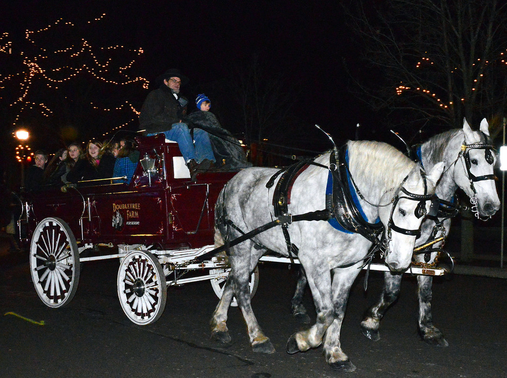 Description of . News-Herald photo — DEBBY HIGH Old-fashioned carriage rides gallop through Perkasie.
