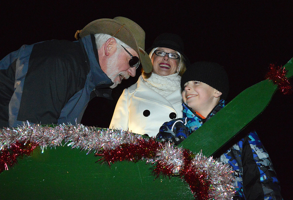 Description of . News-Herald photo — DEBBY HIGH Perkasie Mayor John Hollenbach and Hope Fisher stand with David Ferry, who was chosen to help light the tree.