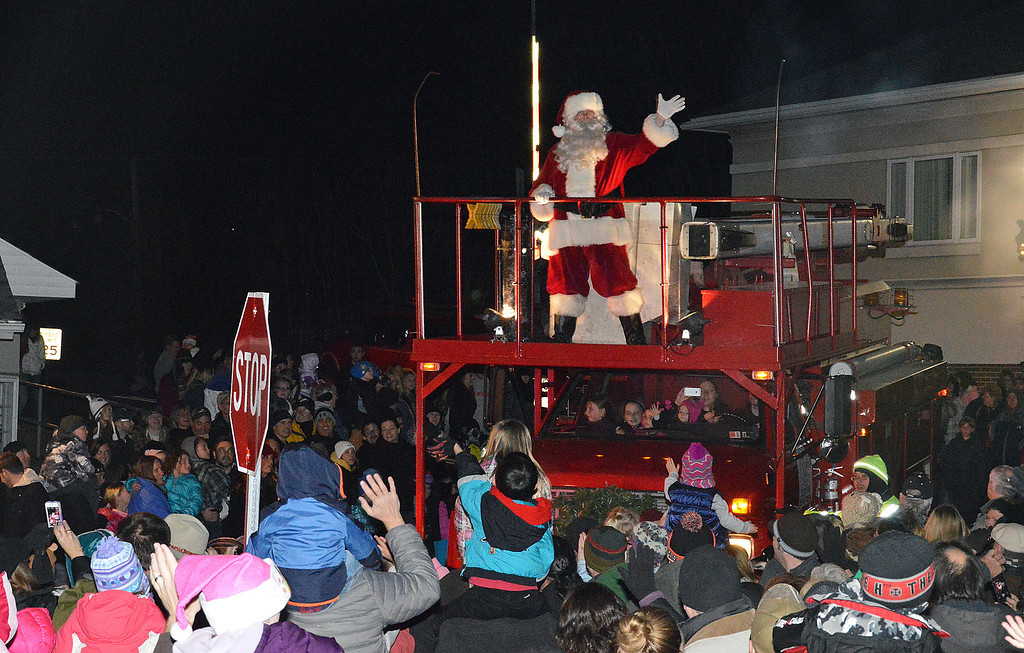 Description of . News-Herald photo — DEBBY HIGH The crowd welcomes Santa to town for America's oldest outdoor community tree lighting.