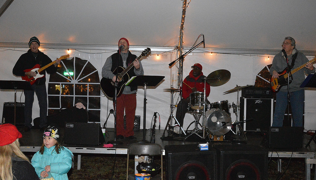Description of . News-Herald photo — DEBBY HIGH Live Christmas music is played throughout the night by Mike Greer & Co.