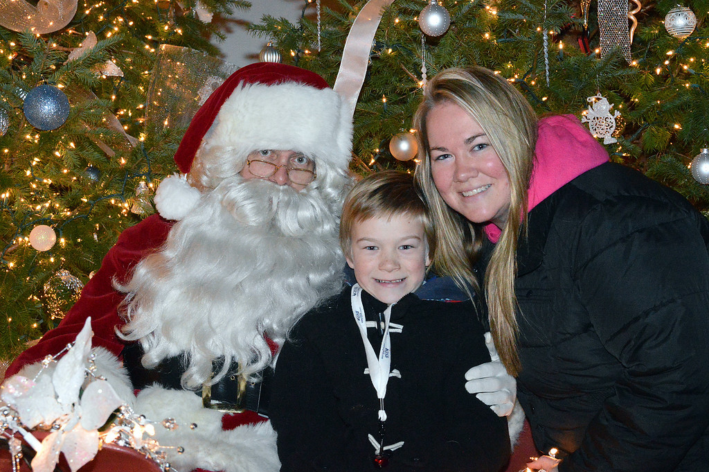 Description of . News-Herald photo — DEBBY HIGH Curtis Nagel meets Santa with his mom, Ashley Nagel.