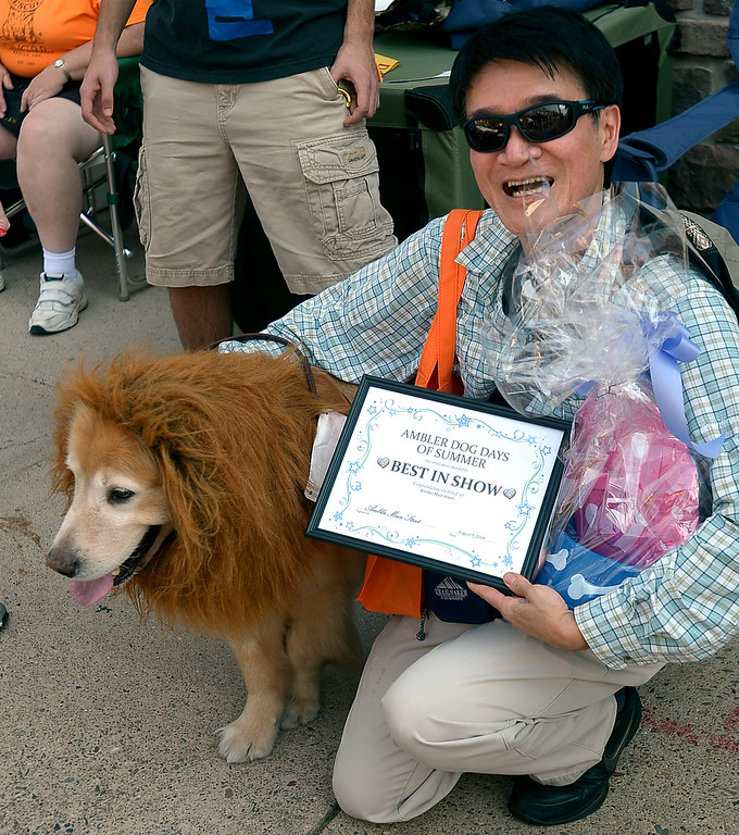 Description of . Best of Show went to Ming Chan and his golden retriever, Art, a rescue dog from Taiwan at the Ambler Dog Days Parade Saturday, Aug. 9, 2014.  Montgomery Media staff photo by Bob Raines