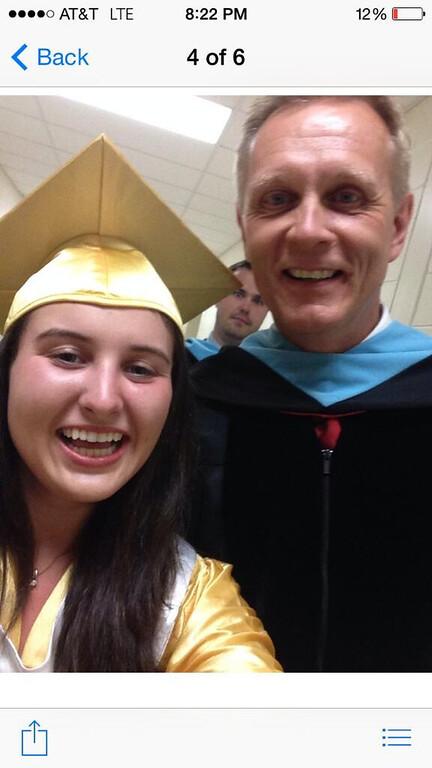 Description of . Alexandra Mosenson takes a selfie.