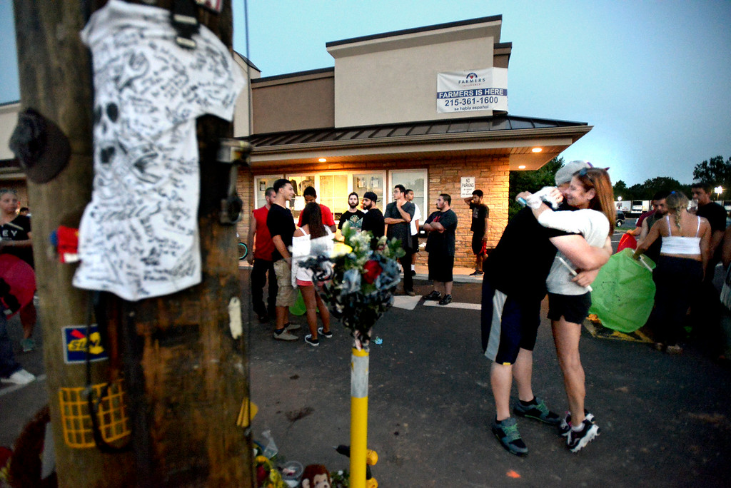 Description of . Mourners gather Monday, Aug. 25, 2014 at the site of a fatal accident along Broad St., Hatfield. Montgomery Media staff photo by Bob Raines