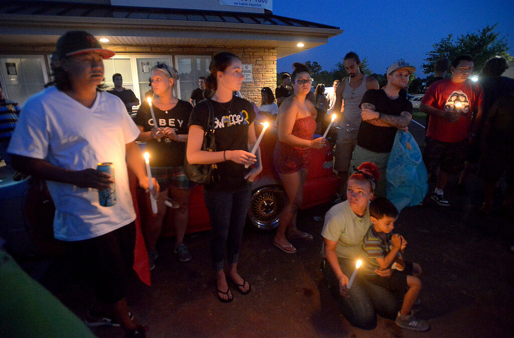 Description of . Friends of the victim of a fatal crash on Broad St., Hatfield hold a vigil Monday night, Aug. 25, 2014. Montgomery Media staff photo by Bob Raines
