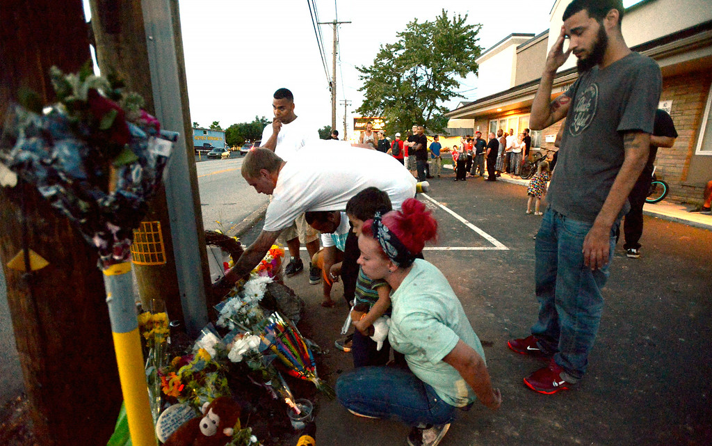 Description of . Mourners gather Monday night, Aug. 25, 2014 at the site of a fatal accident along Broad St., Hatfield. Montgomery Media staff photo by Bob Raines